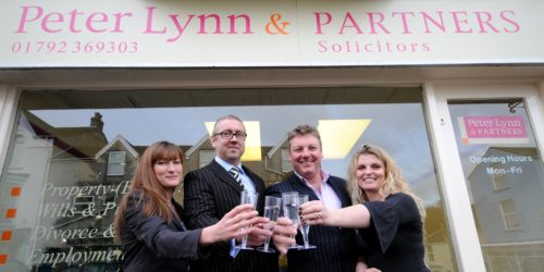 Peter Lynn and staff celebrate Mumbles 1st Year Anniversary
